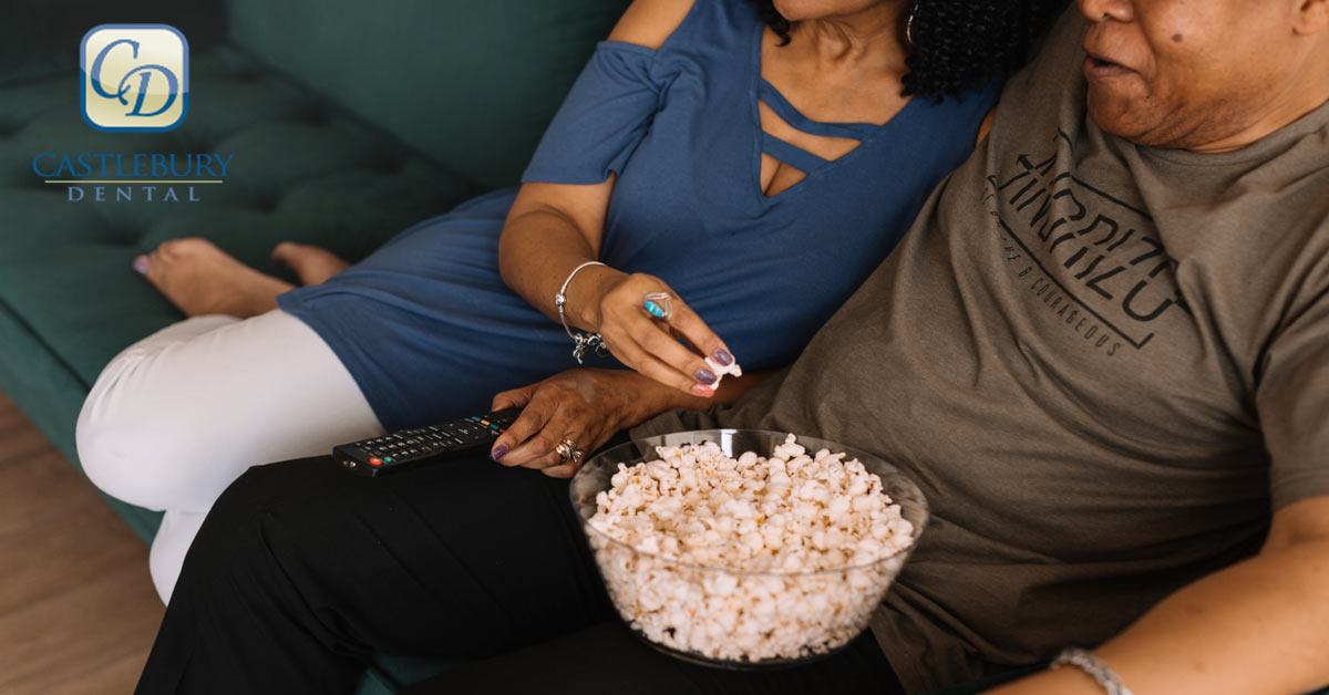 Why Dentists Wish You'd Be More Careful Eating Popcorn